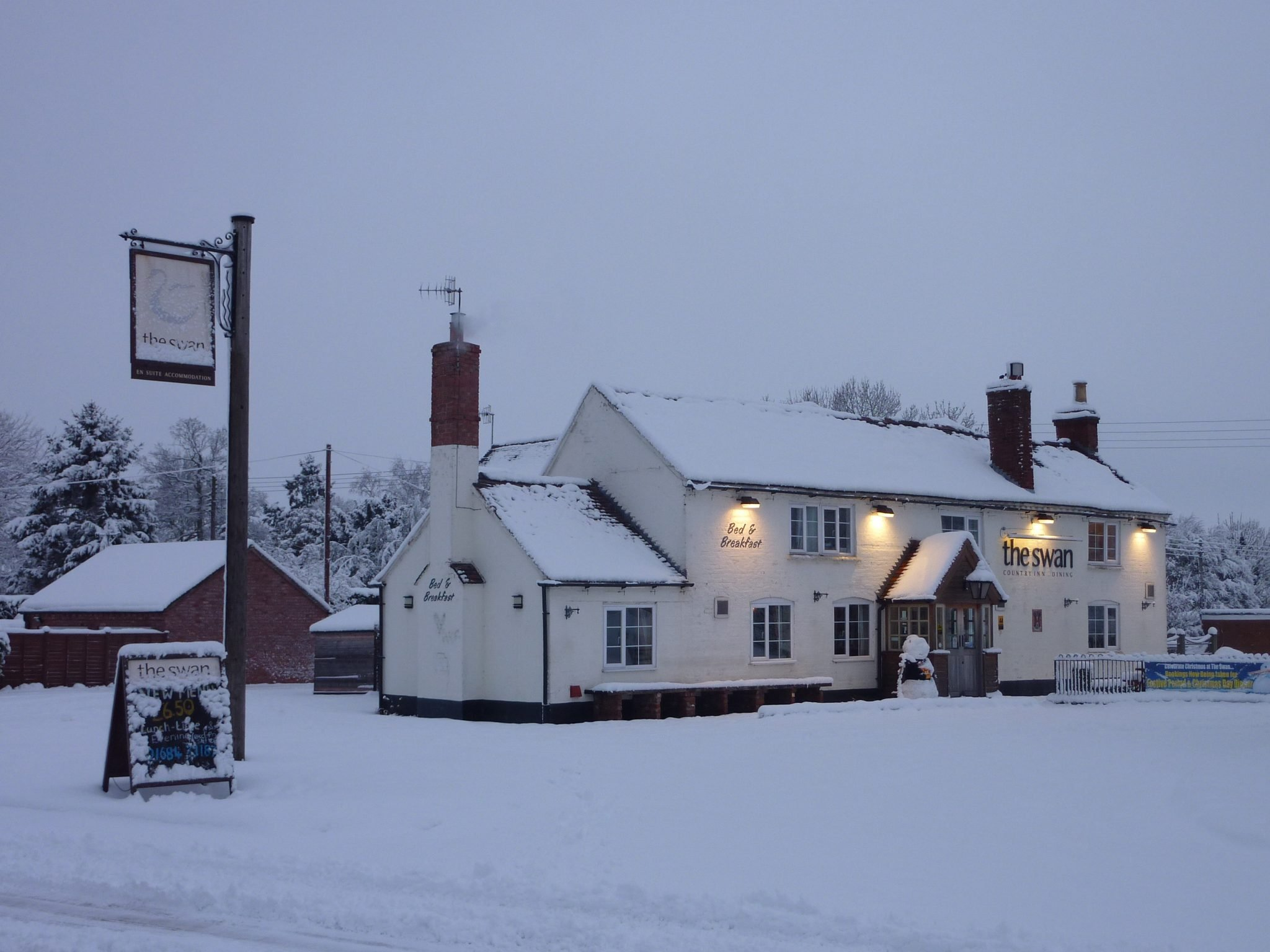 The Swan pub in Hanley Swan in the snow
